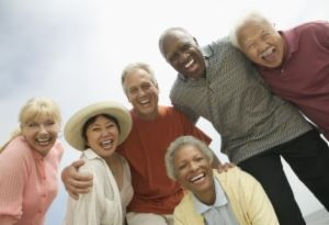 Six senior citizens standing in a group.
